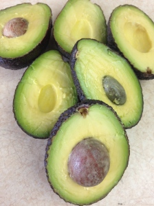 Every good guac starts with perfectly ripe avocados. They should be tender to the touch, dark green on the outside, and light green on the inside.